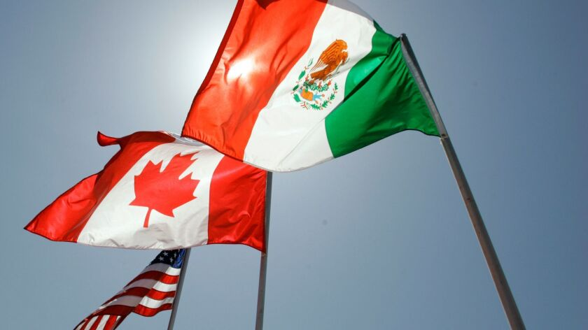 The Trump administration is determined to rewrite NAFTA in ways that it believes would reduce American trade deficits and increase job and manufacturing growth at home. Above, the flags of the United States, Canada and Mexico.