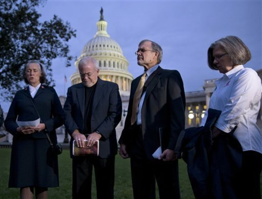 With time growing desperately short for Congress to prevent a threatened Treasury default and stop a partial government shutdown, a group of ministers, the Circle of Protection, pray at dawn at the Capitol to draw attention to lawmakers that political divisiveness hurts the most vulnerable Americ