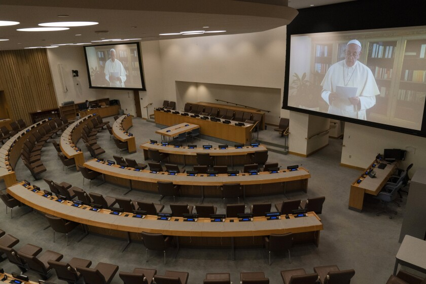 Pope Francis is seen on a video screen in an empty conference room at United Nations headquarters as he speaks in a pre-recorded message addressing the 75th session of the United Nations General Assembly the 75th session of the United Nations General Assembly, Friday, Sept. 25, 2020, at U.N. headquarters. (AP Photo/Mary Altaffer)