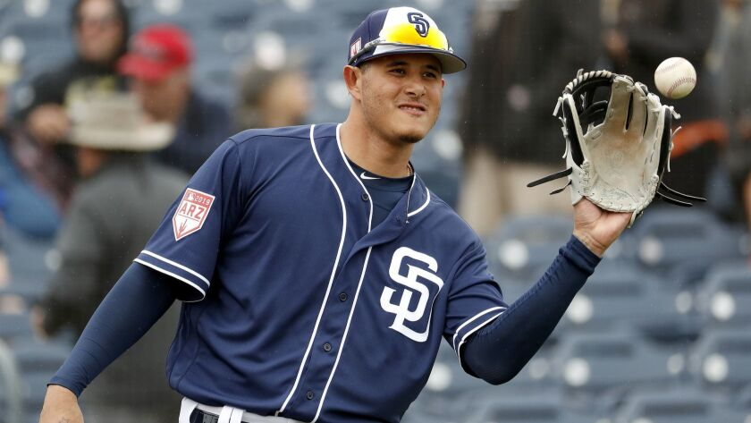 San Diego Padres' Manny Machado warms up prior to his first spring training baseball game of the sea