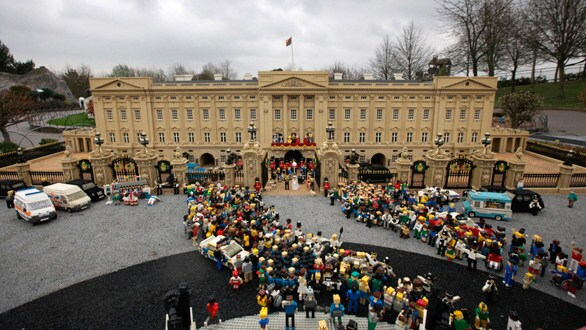 Wedding guests and well-wishers made entirely of Legos in front of the 160,000-brick Buckingham Palace in the Lego royal wedding scene at Legoland Windsor.
