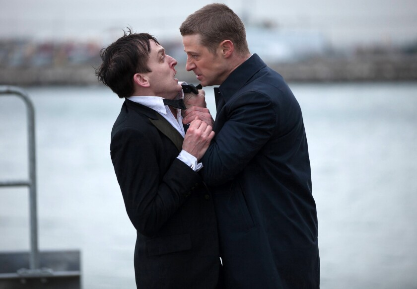 """In this image released by Fox, Robin Lord Taylor, left, and Ben McKenzie, are shown in a scene from """"Gotham,"""" which premiered on Monday, Sept. 22."""