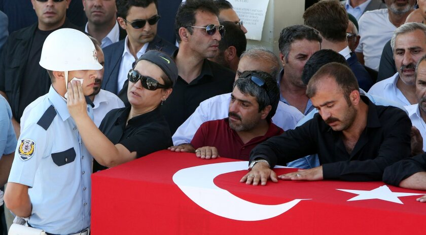 Mourners pray at a funeral at Kocatepe Mosque, in Ankara, Turkey, for people who were killed in the coup attempt.