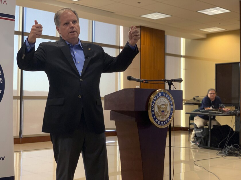 "U.S. Sen. Doug Jones addresses the House impeachment inquiry of President Donald Trump during a Sept.30, 2019 town hall on the campus of Wallace State Community College in Hanceville, Ala. The prospect of an impeachment vote in the Senate is potentially complicating an already tough election fight for the red state Democrat. ""If,"" he said, repeating the word to emphasize the uncertainty. ""If it comes over to the Senate, then I will vote my conscience based on the evidence and not the politics of anything."" (AP Photo/Kim Chandler)"