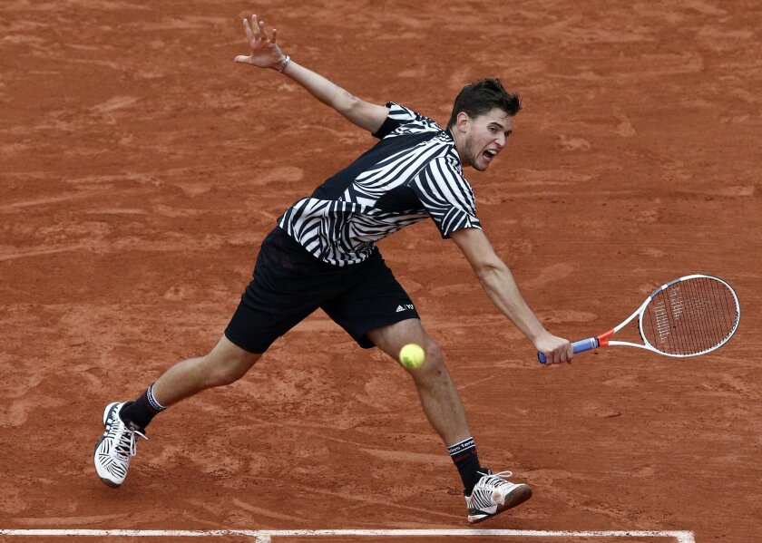 Austria's Dominic Thiem returns the ball to Serbia's Novak Djokovic during their semifinal match of the French Open tennis tournament at the Roland Garros stadium, Friday, June 3, 2016 in Paris. (AP Photo/Christophe Ena)