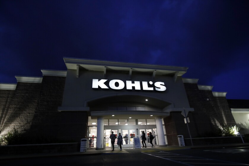FILE - In this Friday, Nov. 29, 2019 file photo, customers walk outside of a Kohl's store in Colma, Calif. Even though the holiday season is winding down, you can still get a good bargain. Go to stores in person to avoid costly online shipping fees and shop Super Saturday sales at major retailers, among other strategies. (AP Photo/Jeff Chiu, File)