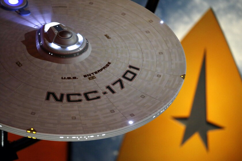 """A model of the USS Enterprise hangs above an exhibit for a 50th anniversary celebration of the """"Star Trek"""" franchise at Seattle's Experience Music Project Museum."""