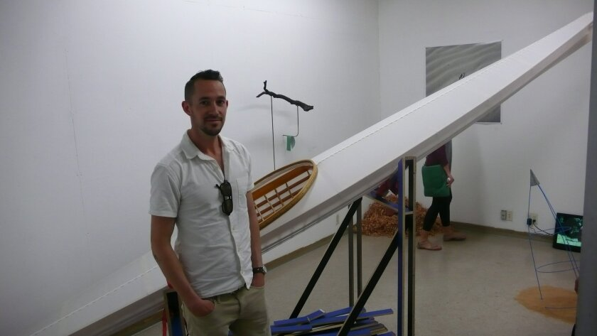 Trevor Amery with his life-sized kayak schulpture