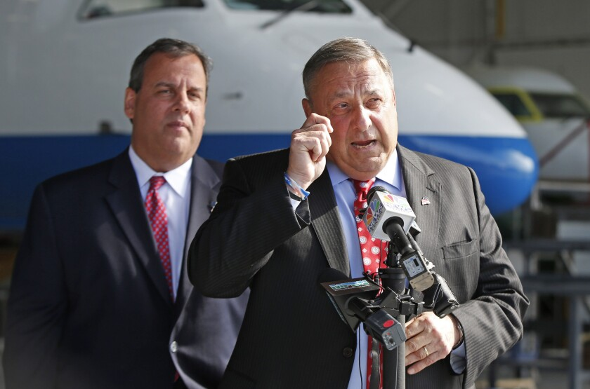 One does, the other doesn't: New Jersey's GOP Gov. Chris Christie, left, expanded Medicaid under the Affordable Care Act; Maine's GOP Gov. Paul LePage, right, has refused, but trails in his reelection race.