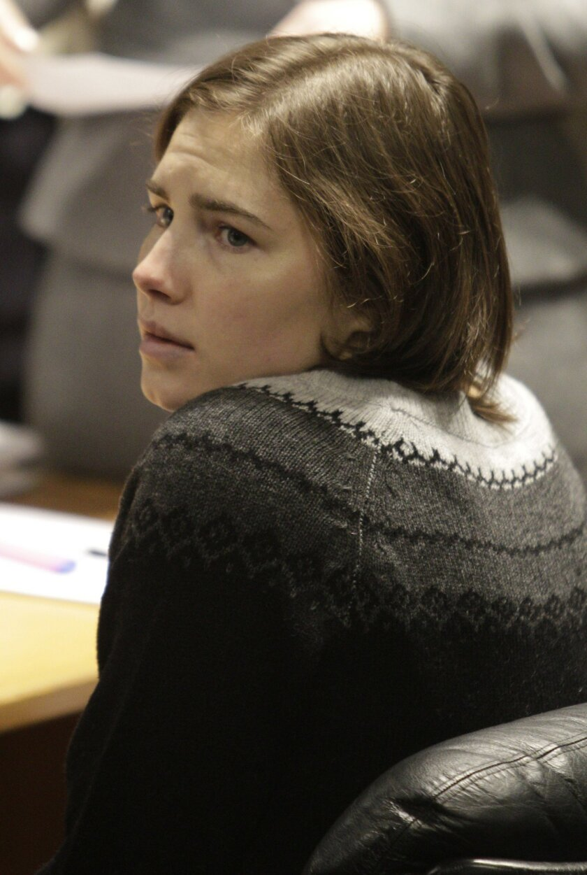File-This Dec. 11, 2010,  file photo shows  Amanda Knox sitting at the beginning of a hearing in her appeals trial, at Perugia's courthouse, Italy. To many Americans, especially in her hometown of Seattle, Amanda Knox seems the victim, unfairly hounded by a capricious foreign legal system for the d