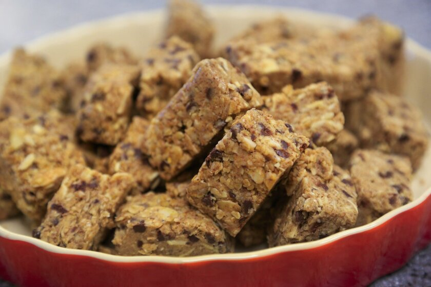 Breakfast Bar, prepared with 2 cups quick cooking oats, 1 cup almond butter, 1/2 cup sliced almonds, 1/2 cup mini chocolate chips, 1/4 cup honey and optional salt and cinnamon to taste.