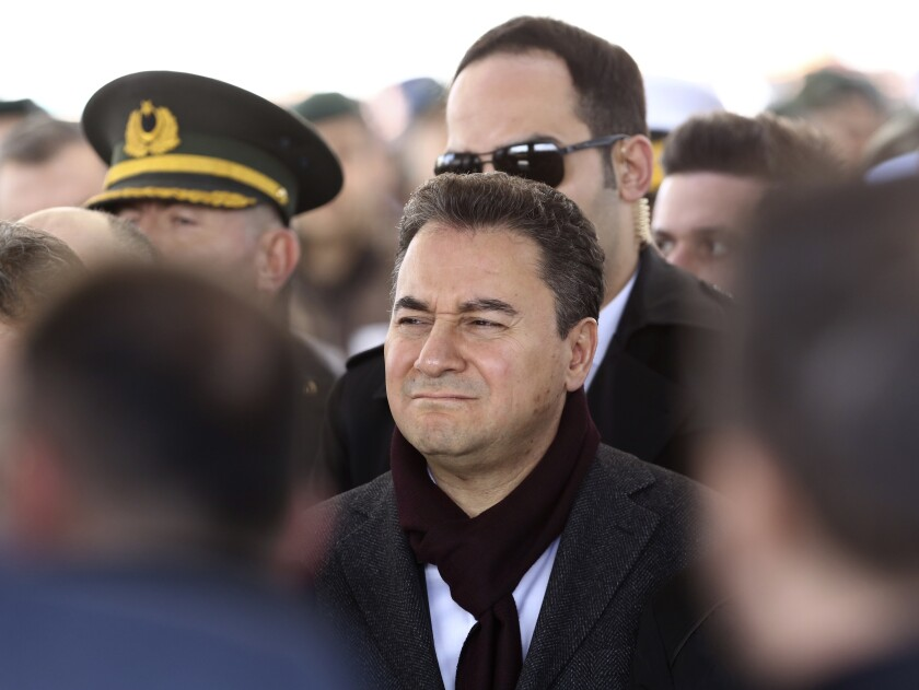 FILE - In this March 1, 2020 file photo, Ali Babacan attends funerals for a Turkish soldier killed in Syria, in Ankara, Turkey. Babacan, who held various high level government positions between 2002-2015, established a new political party on Monday March 9, 2020, the second former ally of President Recep Tayyip Erdogan to breakaway from the ruling party and form a new movement to challenge his rule.(AP Photo/Burhan Ozbilici, File)