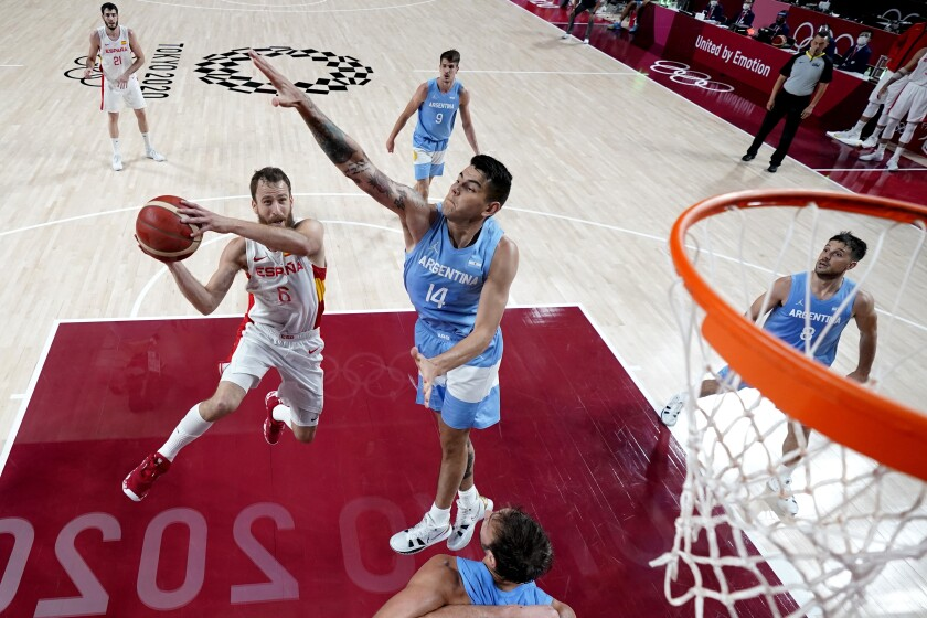 Spain's Sergio Rodriguez (6) drives to the basket against Argentina's Gabriel Deck (14) during a men's basketball preliminary round game at the 2020 Summer Olympics, Thursday, July 29, 2021, in Saitama, Japan. (AP Photo/Eric Gay)