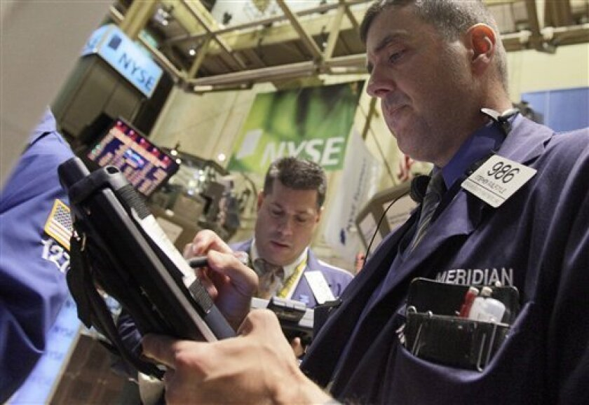 In this photo made June 7, 2010, traders William McInerney, center, and Stephen Guilfoyle work on the floor of the New York Stock Exchange Monday, June 7, 2010. (AP Photo/Richard Drew)