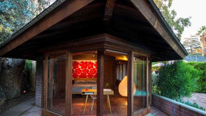 Marimekko textiles and a Noguchi lamp liven up the master bedroom, originally a sleeping porch.