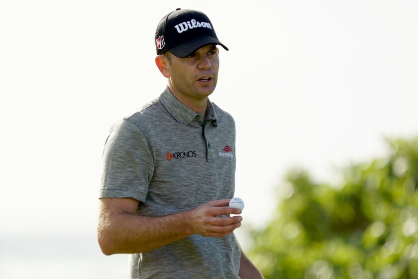 Brendan Steele acknowledges the gallery on the 16th green during the second round of the Sony Open PGA Tour golf event, Friday, Jan. 10, 2020, at Waialae Country Club in Honolulu. (AP Photo/Matt York)