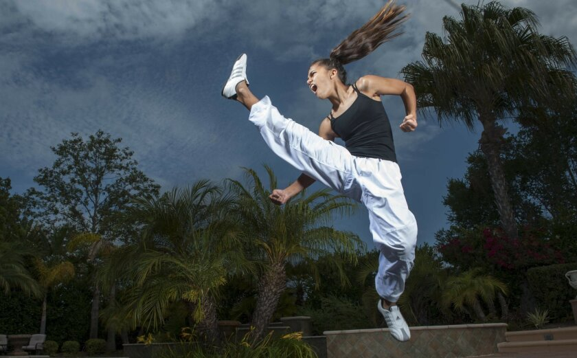 Rayna Vallandingham, 12, demonstrates her world championship-winning moves at her home in Encinitas. Michael Cali • U-T