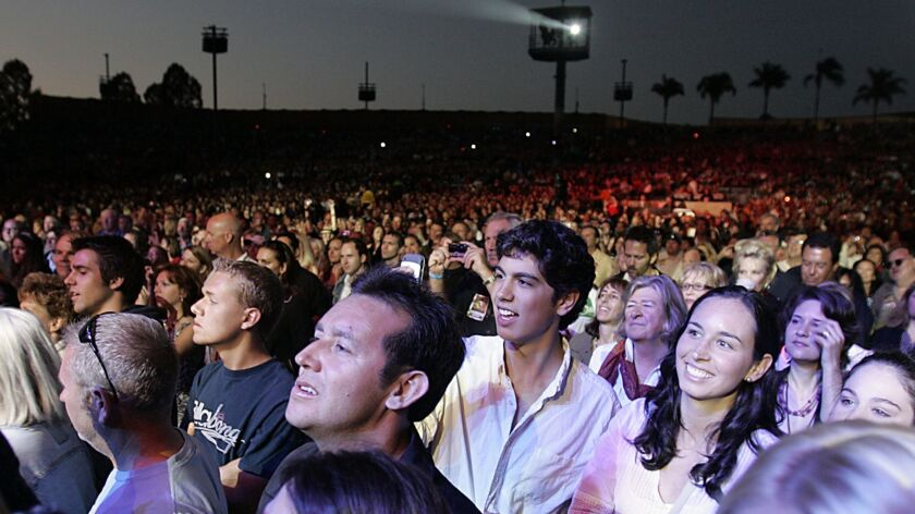 The audience enjoys Elton John's 2010 concert at Cricket Wireless Amphitheater in Chula Vista. The venue, which opened as Coors Amphitheatre in 1998, is now known as Mattress Firm Amphitheatre.