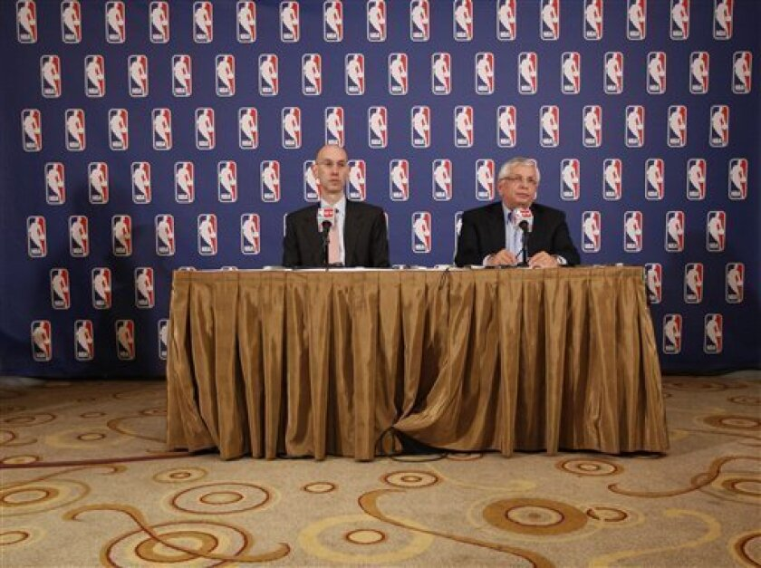 NBA commissioner David Stern, right, and deputy commissioner Adam Silver speak to reporters after a meeting with the players' union, Thursday, June 30, 2011 in New York. Despite a three-hour meeting Thursday, the sides could not close the enormous gap that remained in their positions. (AP Photo/Mar