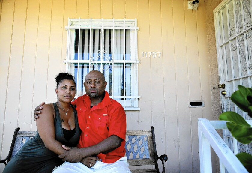 Tyesha Hansborough, left, and Christley Paton have battled for months to resolve an insurance policy lapse that they blame on their mortgage servicer.