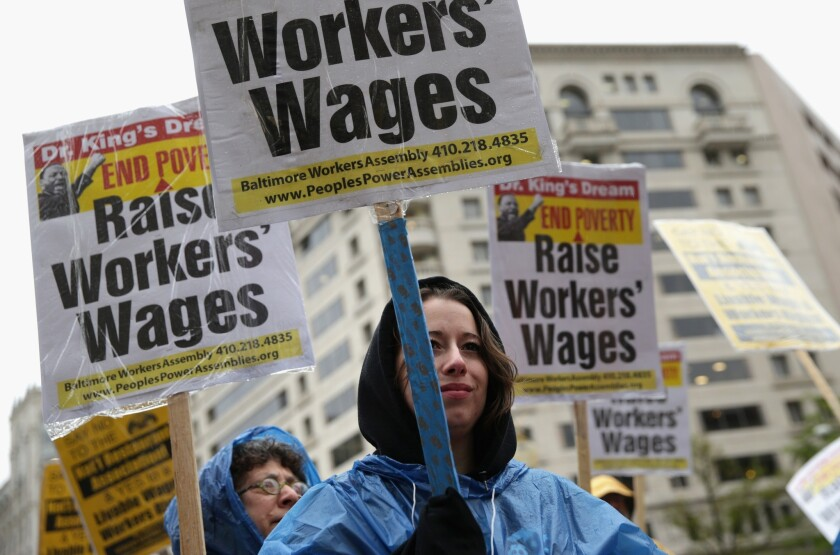 Fast-food worker Daniella Longchamps of Baltimore and others demonstrate in Washington for a higher minimum wage.