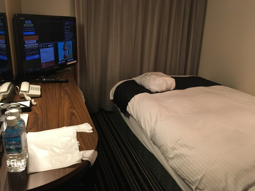 This photo shows an interior of hotel room where some passengers who returned to Japan from London are in quarantine, in Tokyo on Feb. 1, 2021. The room has a single bed (120cm x 195cm), a humidifier, an air purifier, and 32-inch screen TV monitor. Because of the emergence in Japan of new coronavirus variants, all people traveling from Level 3 countries and regions, the U.K., South Africa, Ireland and parts of Brazil, have to quarantine at a location designated by the government, usually a hotel near the airport, for at least the first three days. Those who test negative for the virus on their third day can then leave, but they have to remain in self-isolation elsewhere for 11 more days to complete the quarantine. (AP Photo/Mayuko Ono)
