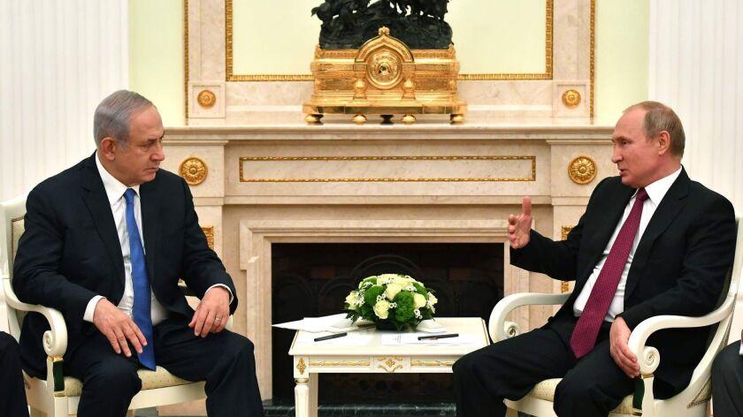Russian President Vladimir Putin speaks with Israeli Prime Minister Benjamin Netanyahu during their meeting at the Kremlin in Moscow on July 11, 2018.