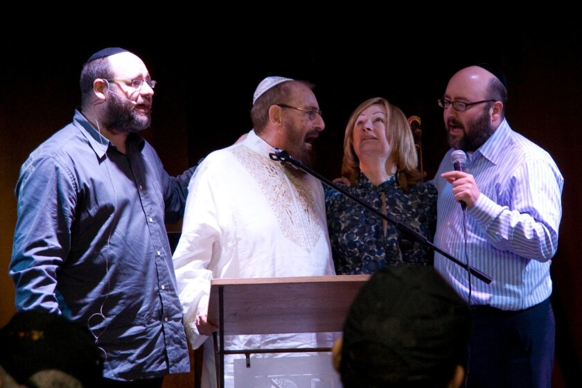 Yehudah Berg, left, Rabbi Phlip Berg, Karen Berg and Michael Berg in 2009. Rabbi Yehuda Berg and the Kabbalah Center were ordered to pay $177,500 to a woman who alleged that Berg plied her with drugs and alcohol with the intent of raping her.