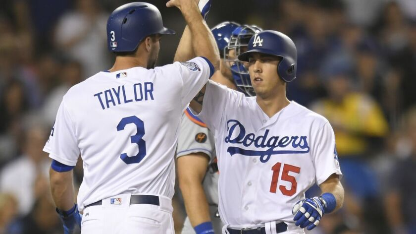 Los Angeles Dodgers' Chris Taylor congratulates Austin Barnes on his two-run home run against the Ne