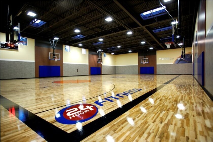 The 24 Hour Fitness chain is relocating and expanding three San Diego County clubs. Each will add amenities such as this basketball court, pictured at the El Cajon location.