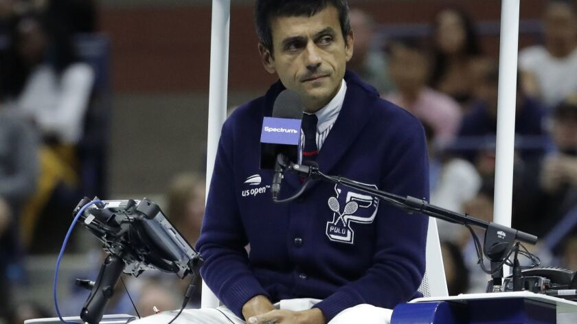 Chair umpire Carlos Ramos watches play as he officiates the match between Serena Williams and Naomi