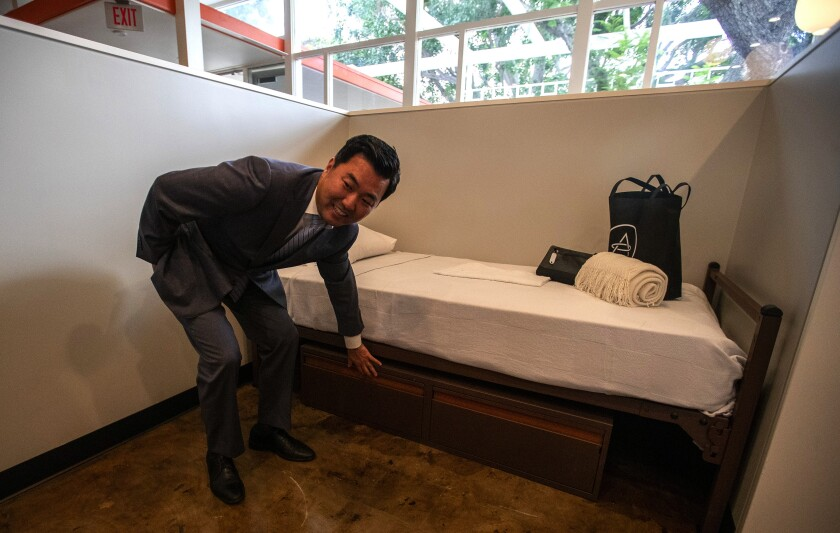 Los Angeles City Councilman David Ryu tours a 30-bed homeless center in Hollywood.