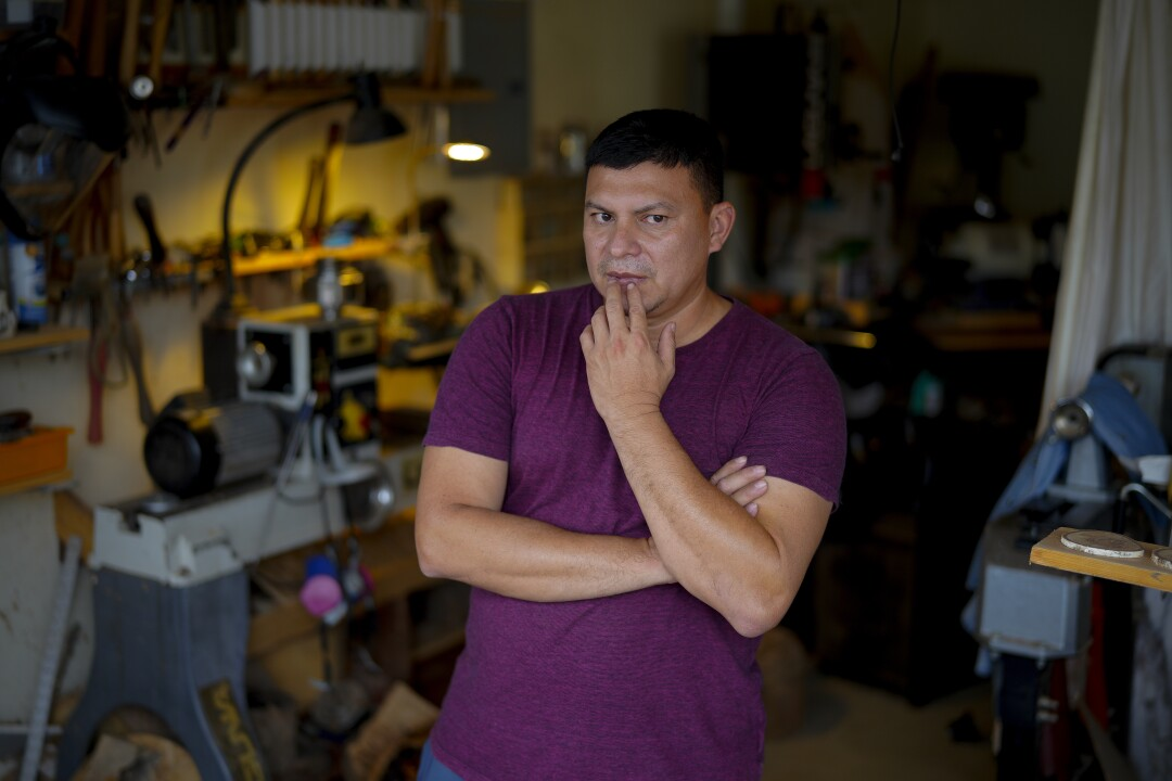 Ernesto Aquino at his wood shop in the garage of his home in Fallbrook.