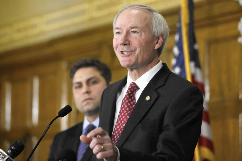 Leading companies including Wal-Mart have called upon Arkansas Gov. Asa Hutchinson to veto a religious freedom bill that many believe would sanction discrimination based on sexual orientation.