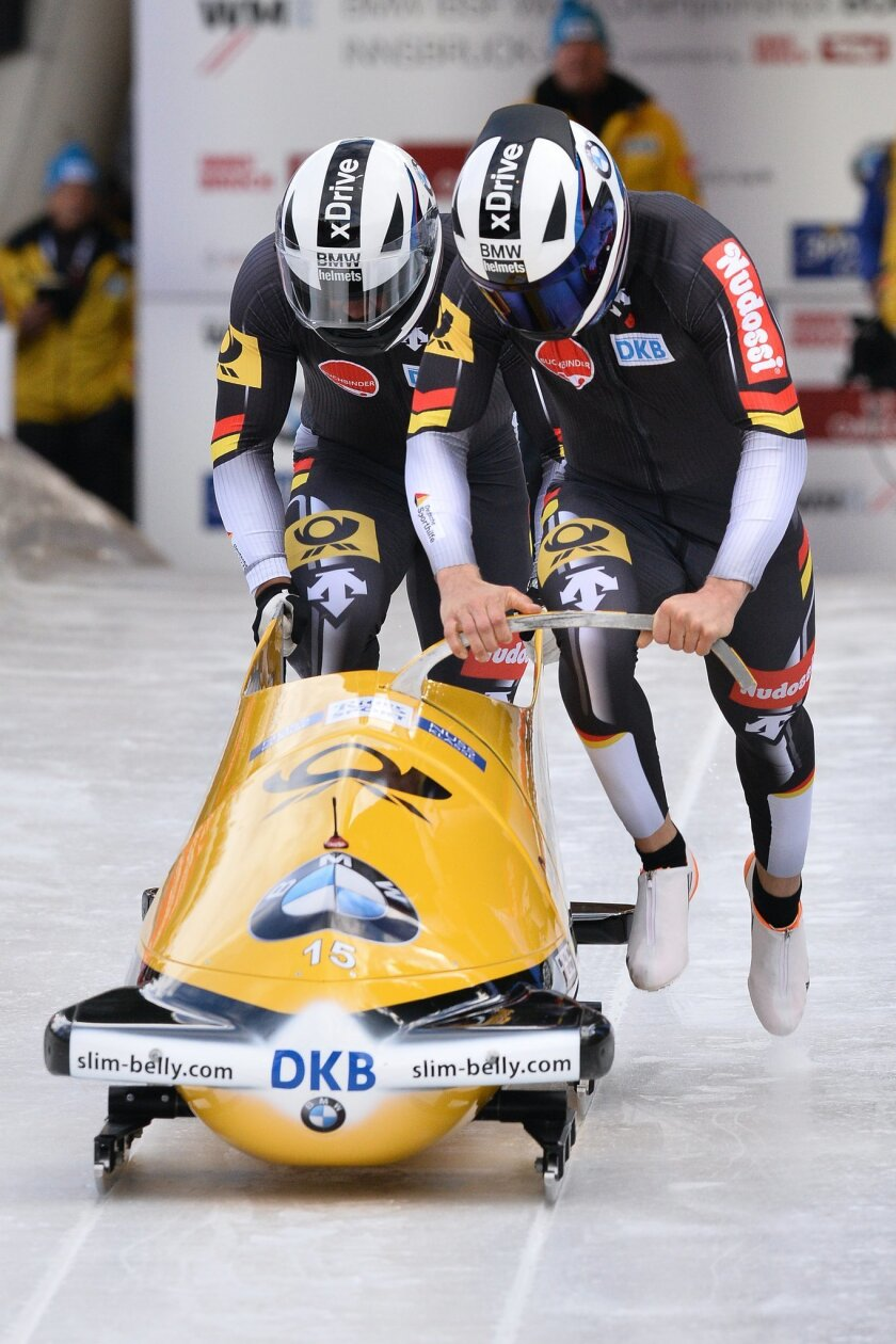 Johannes Lochner and Joshua Bluhm of Germany during the start of the  two-man bobsled  race at the Bob World Championships  in Igls, near Innsbruck, on Saturday, Feb. 13, 2016. (AP Photo/Kerstin Joensson)