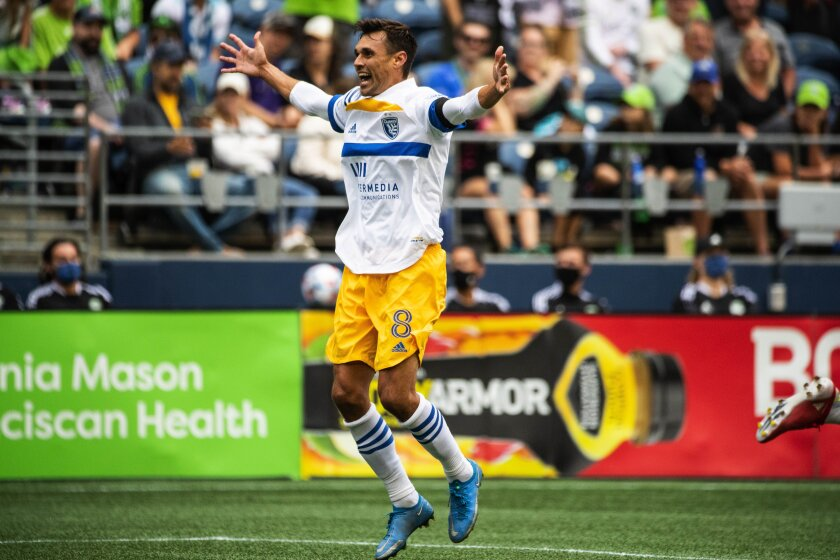 San Jose Earthquakes attacker Chris Wondolowski celebrates after what appeared to be a San Jose goal near the end of the team's MLS soccer match against the Seattle Sounders on Saturday, July 31, 2021, in Seattle. The referee disallowed the goal. (Dean Rutz/The Seattle Times via AP)