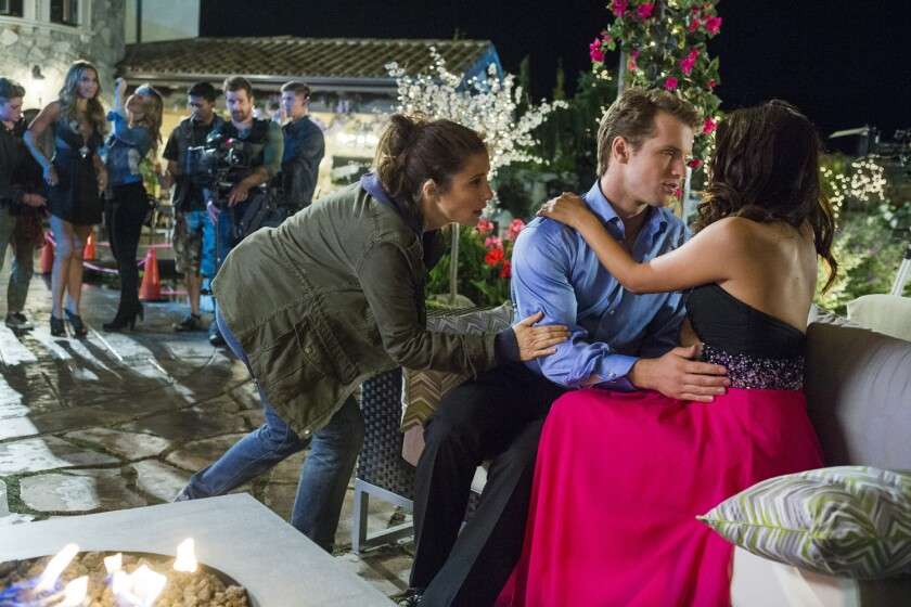 A former staffer from 'The Bachelor' has made a new show, 'unREAL,' that gives viewers a behind-the-scenes look at reality television