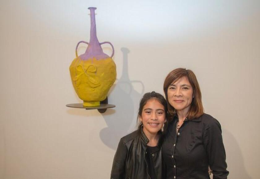 Young art-lover Isabela Solterro and her mother, Nida, gravitate toward one of Francis Upritchard's polymer vessels at Lux Art Institute.
