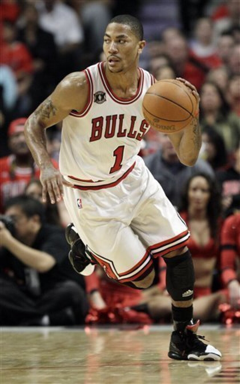 Chicago Bulls point guard Derrick Rose brings the ball up against the Indiana Pacers during the third quarter in Game 5 of a first-round NBA playoffs basketball series on Tuesday, April 26, 2011, in Chicago. The Bulls won 116-89 and won the series 4-1. (AP Photo/Nam Y. Huh)