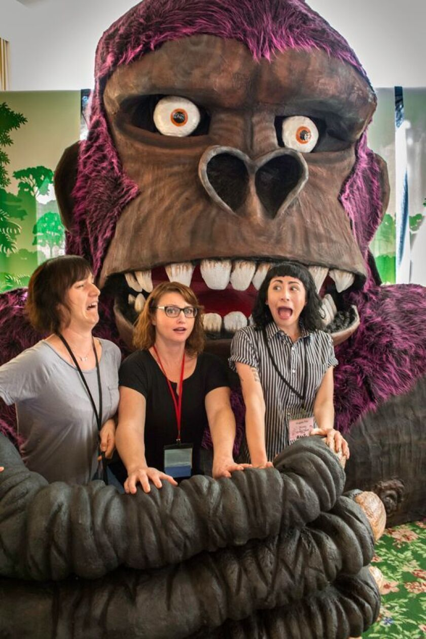 Captured by King Kong at last year's San Diego Comic Fest, from left, are Anna Culbertson, Pamela Jackson and Angela Risi. The life-sized Kong was created by Robert Maya.