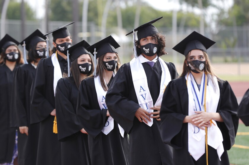 Early College High School graduates enter Jim Scott Stadium at Estancia High for their 2021 commencement ceremony Thursday.