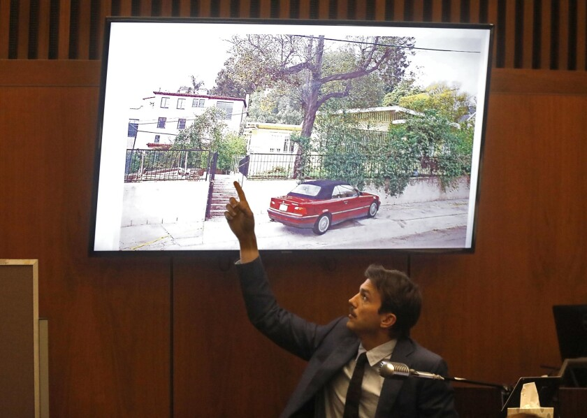 LOS ANGELES, CA - MAY 29, 2019 - - Ashton Kutcher points to a drawing of stabbing victim Ashley Elle