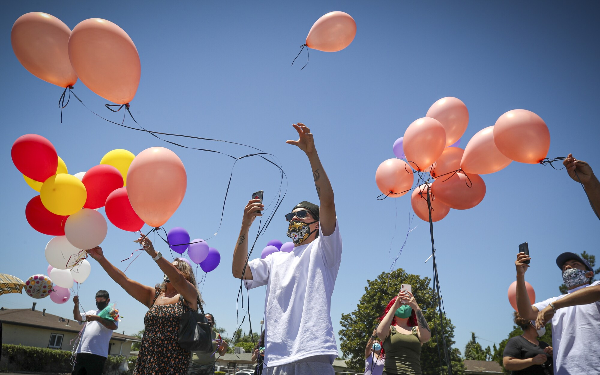 Mourners release balloons at a memorial service for Lucy Reyes.