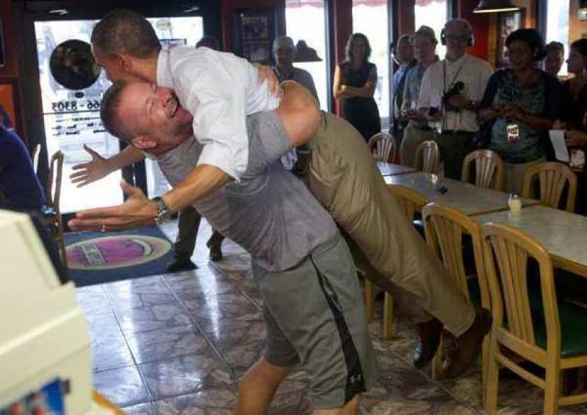 President Obama is picked up by Scott Van Duzer, owner of Big Apple Pizza, during a visit to the restaurant in Fort Pierce, Fla.