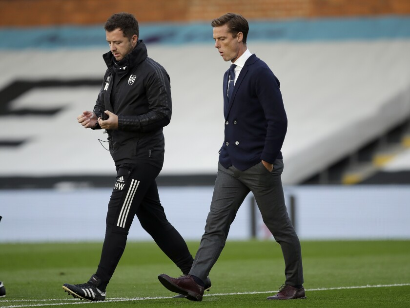 Fulham's manager Scott Parker, right, arrives for the English Premier League soccer match between FC Fulham and Aston Villa in London, England, Monday, Sept. 28, 2020. (AP Photo/Matt Dunham, Pool)
