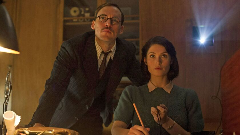 "Sam Claflin as Tom Buckley and Gemma Arterton as Catrin Cole in the film ""Their Finest."""
