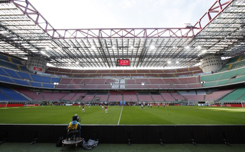 A view of the empty stadium during the Serie A soccer match between AC Milan and Genoa at the San Siro stadium, in Milan, Italy, Sunday, March 8, 2020. Serie A played on Sunday despite calls from Italy's sports minister and players' association president to suspend the games in Italy's top soccer division. (AP Photo/Antonio Calanni)