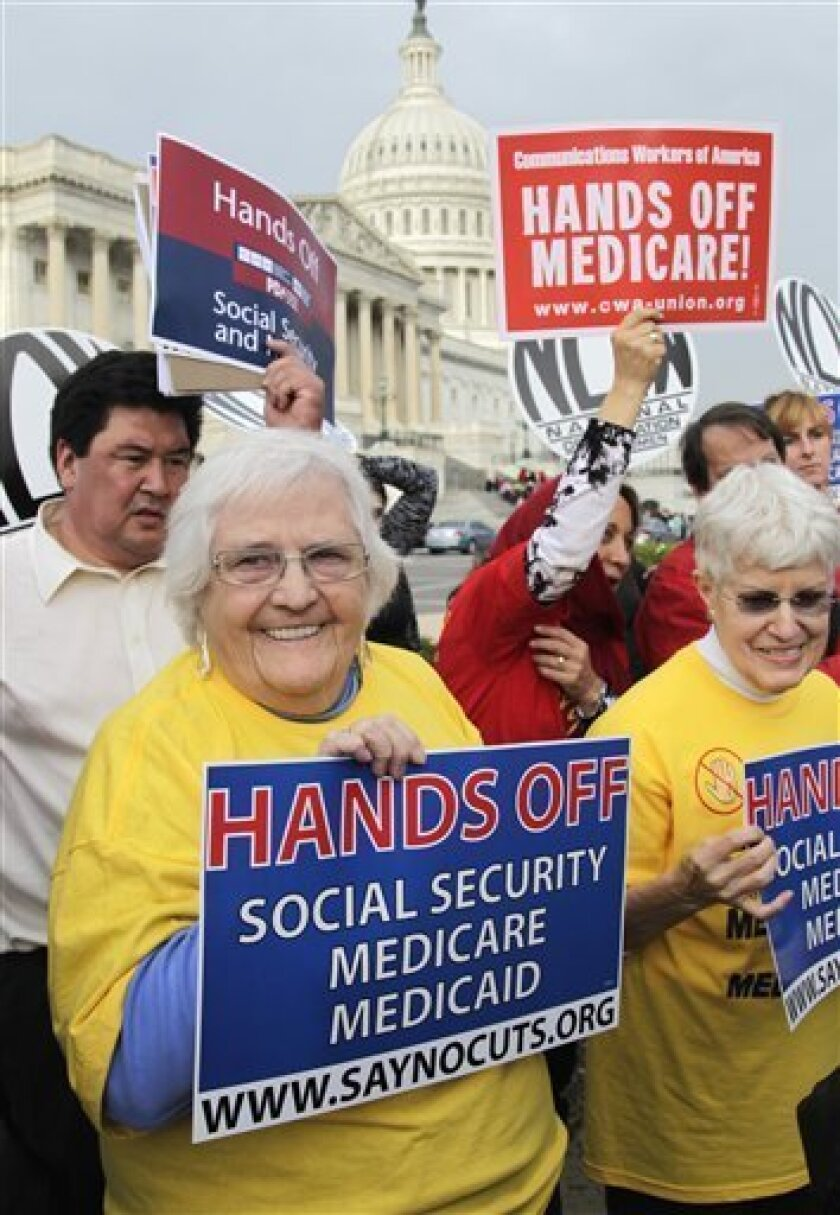 Sue Ward, of Upper Marlboro, Md., left, a member of the National Committee to Preserve Social Security and Medicare, joins members of Congress and union members on Capitol  Hill in Washington, Wednesday, Oct. 26, 2011, to voice their opposition to potential cuts in Medicare, Medicaid, and Social Se