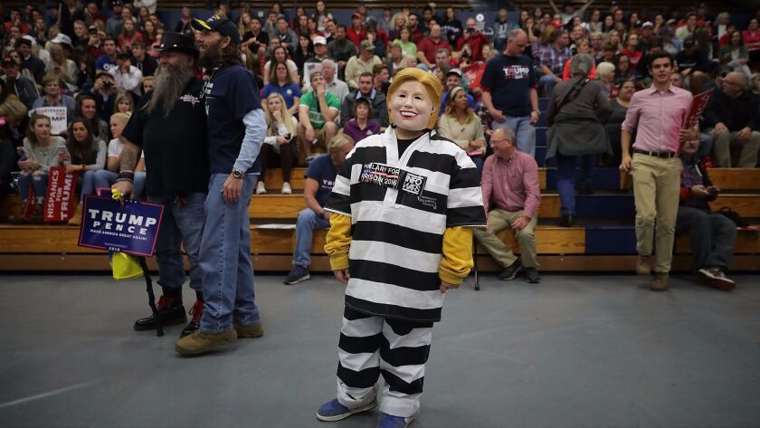 A 10-year-old supporter of Donald Trump dresses as Hillary Clinton in prison garb while attending a rally Nov. 1 in Eau Claire, Wis.