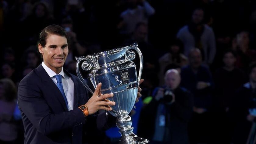 Spain's Rafael Nadal reacts after being presented with the ATP World Tour No. 1 Trophy at the O2 Arena in London, Britain, 12 November 2017. EFE